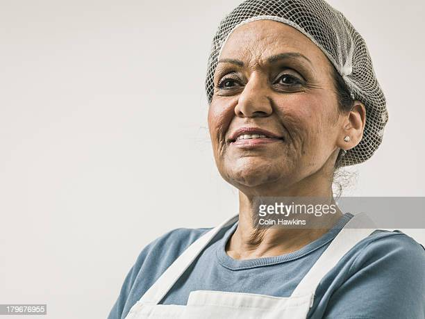 senior female wearing hygiene clothing - colin hawkins stock pictures, royalty-free photos & images