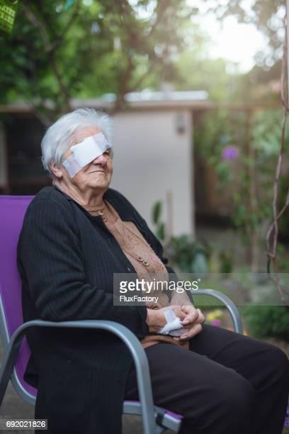 Senior female with bandage from cataract operation