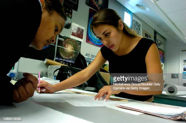 Senior Flor Macias right helps Adriana Avila junior work on a physics project to understand how mirrors work in a Boulder High School classroom on...