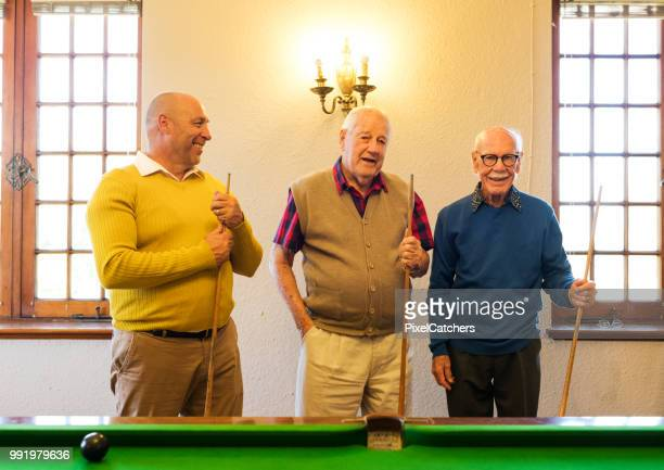 Senior friends about to begin a game of pool
