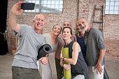 happy senior man taking selfie with
