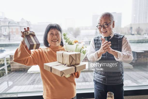 senior friends enjoying retirement party in cafe - disruptaging stock pictures, royalty-free photos & images