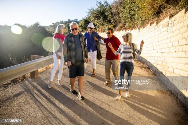 senior friends going to the beach - rancho palos verdes stock pictures, royalty-free photos & images
