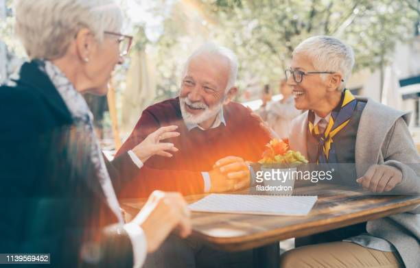 senior friends have fun - young at heart stock pictures, royalty-free photos & images