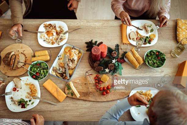 senior friends having food and drinks - leftovers stock pictures, royalty-free photos & images