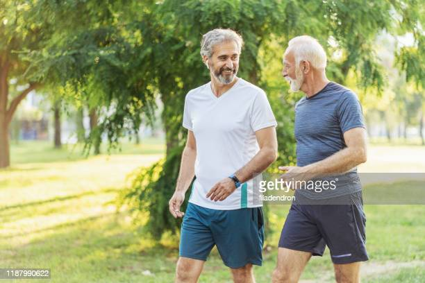 senior friends jogging - relaxation exercise stock pictures, royalty-free photos & images