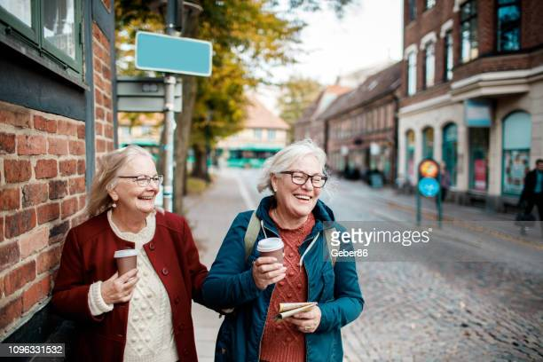 senior friends - disruptagingcollection stock photos and pictures