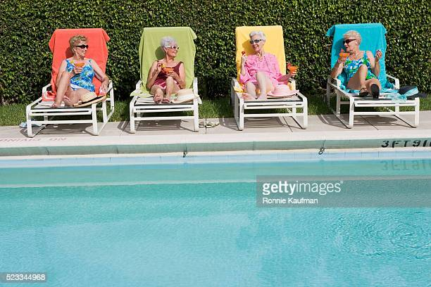 Senior Friends Poolside with Drinks