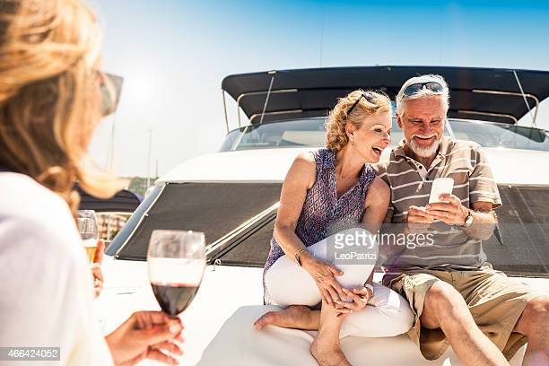Senior friends relaxing on a luxury yacht