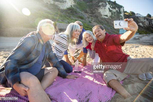 senior friends taking selfie at picnic - friendly match stock pictures, royalty-free photos & images