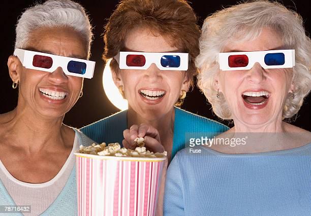 Senior Friends Watching 3-D Movie