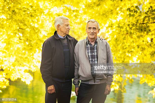 Senior gay couple Autumn portrait in park