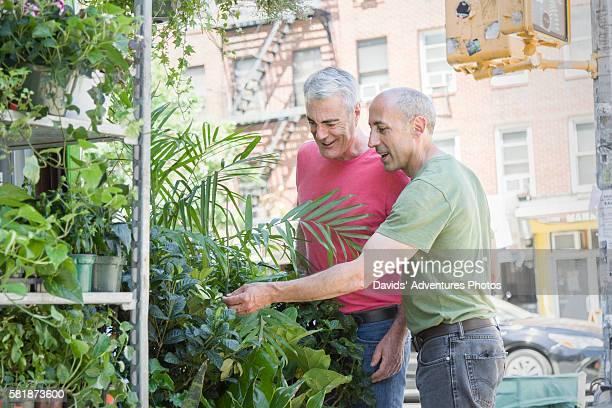 Senior Gay Couple Shopping for Houseplants on New York City Street