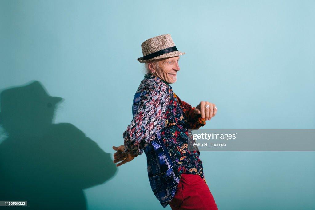 Senior Gay Man in Colorful Shirt Dancing : Stock Photo