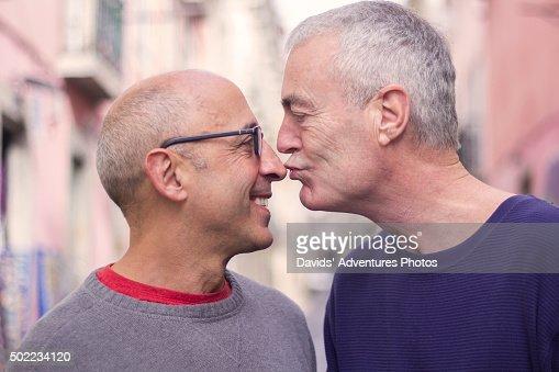 Senior Gay Man Kissing Nose Of Partner While On Vacation ...