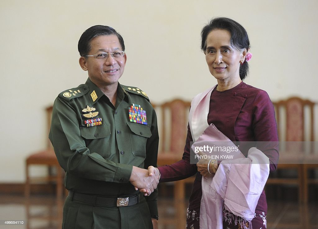 Senior General Min Aung Hlaing, Myanmar Commander In-Chief (L) and National League for Democracy (NLD) party leader Aung San Suu Kyi (R) shake hands after their meeting at the Commander in-Chief's office in Naypyidaw on December 2, 2015. Myanmar's democracy leader Aung San Suu Kyi began talks with the nation's army-backed president on the handover of power on December 2 nearly a month after her opposition party cleaned up at the polls. AFP / PHYO HEIN KYAW / AFP / Phyo Hein Kyaw