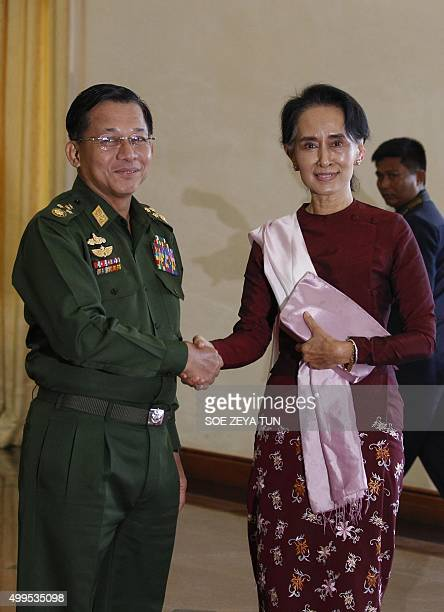 Senior General Min Aung Hlaing Myanmar Commander InChief shakes hands with National League for Democracy party leader Aung San Suu Kyi before their...
