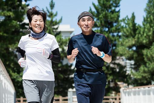 Senior generation enjoying jogging with men and women - gettyimageskorea