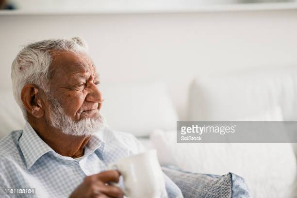 senior gentleman looks into the distance - wisdom stock pictures, royalty-free photos & images