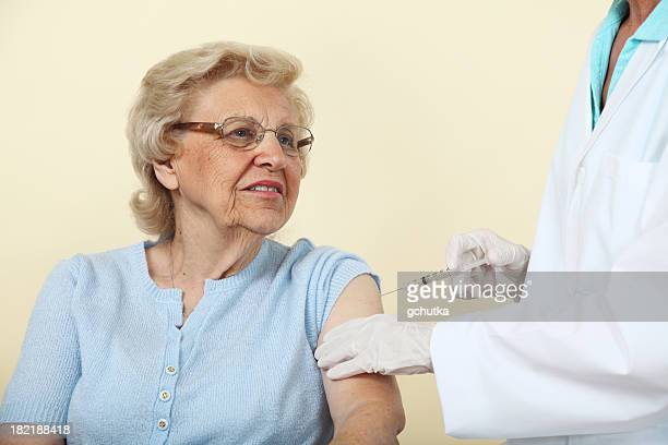 senior getting a shot - gchutka stock pictures, royalty-free photos & images
