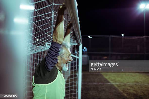 senior goalie - sportsperson stock pictures, royalty-free photos & images