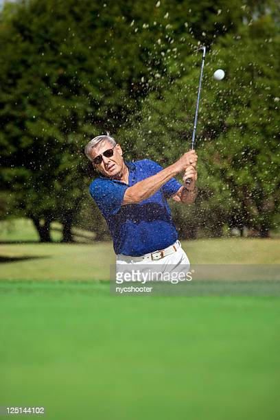 Senior Golfer In Sandtrap On Course
