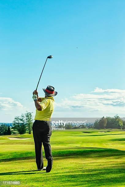 Senior Golfer on Golf Course Teeing Off