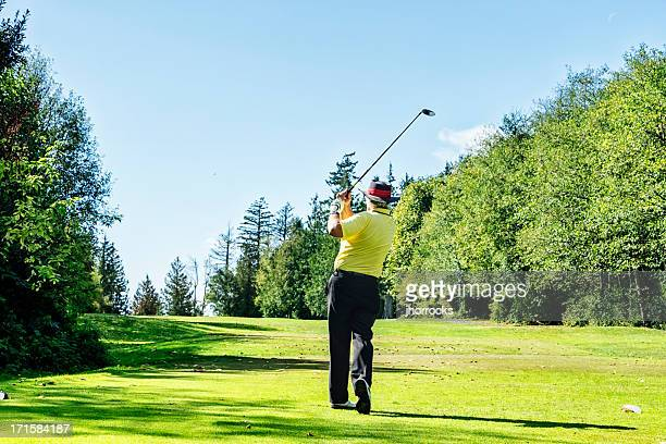Senior Golfer on Golf Course Teeing Off