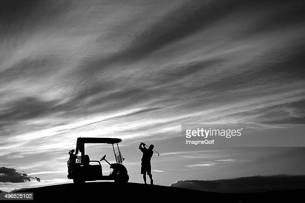 Senior Golfer Swinging by His Golf Cart in Monochrome