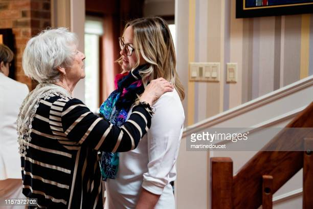 Senior grand-mother and adult grand-daughter hugging.