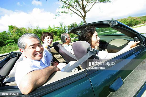 Senior group driving a car