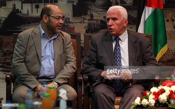 Senior Hamas leader Moussa Abu Marzouk and Azzam AlAhmed a senior Fatah official talk during there meting in Gaza City April 22 2014 The Palestine...