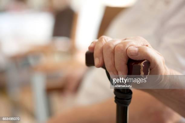Senior Hand With Crutch