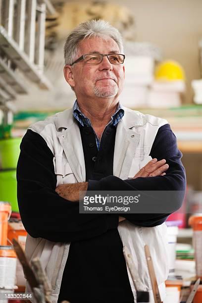 Senior Handyman in a Hardware Store