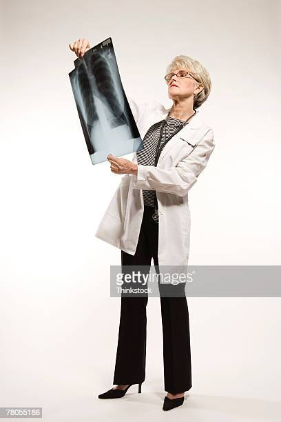 Senior healthcare worker holding x-ray