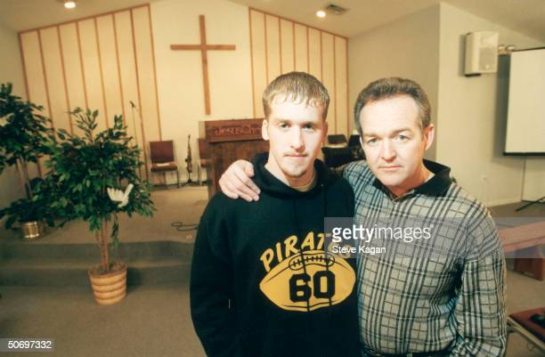 HS senior hero Ben Strong posing w his dad Robert pastor of the Concord Assembly of God in his church after Ben stopped the shooting spree of...