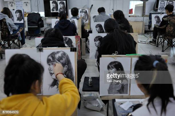 Senior high school students painting the same picture to major in art prepare for the upcoming college entrance exam at a training institute in...