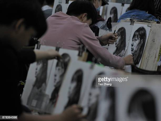 Senior high school students painting to major in art prepare for the upcoming college entrance exam at a training institute in Harbin China's...