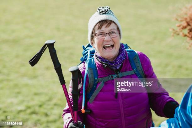 senior hiker enjoying the walk - cultura británica fotografías e imágenes de stock