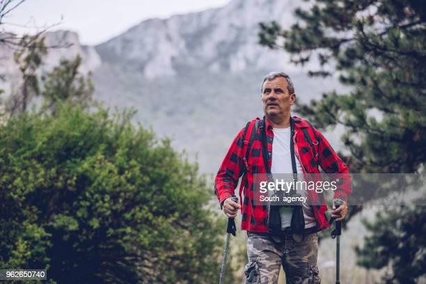 Senior hiker on high mountain