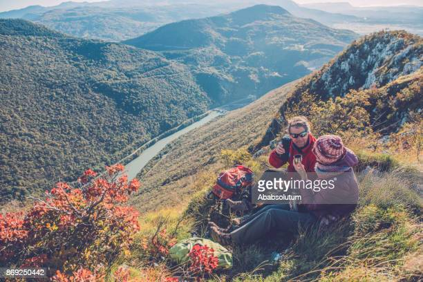 Senior Hikers Drinking Tea at Autumnal Dawn in Southern Julian Alps, Europe
