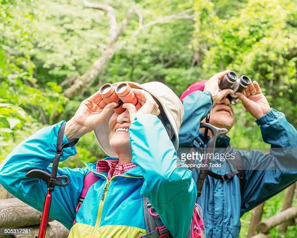 Senior Hikers Looking Through Binoculars