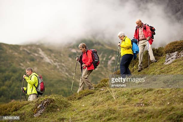 senior hiking group in steep terrain