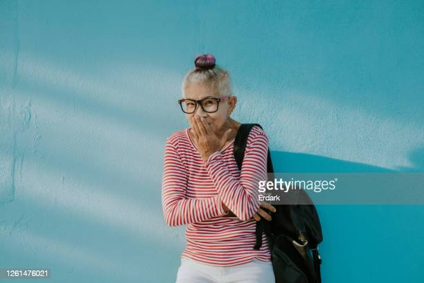 senior hipster thai woman - thai ethnicity stock pictures, royalty-free photos & images