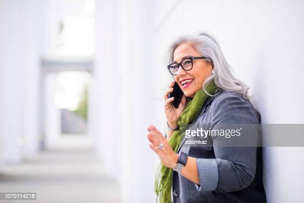 Senior Hispanic Businesswoman on the Phone