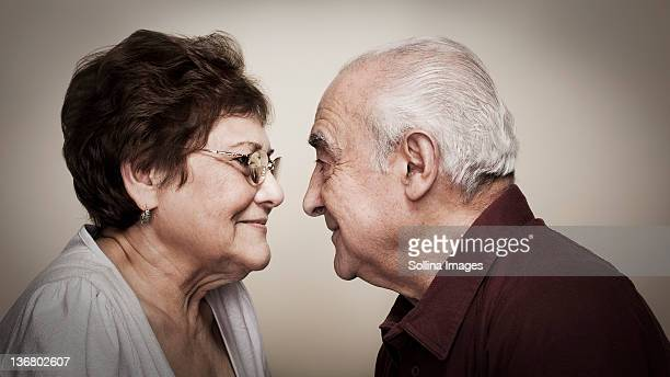 senior hispanic couple face to face - face to face stock pictures, royalty-free photos & images