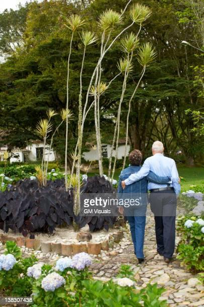 Senior Hispanic couple walking together on path