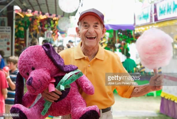 Senior Hispanic man at carnival