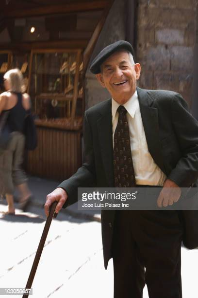 Senior Hispanic man with cane