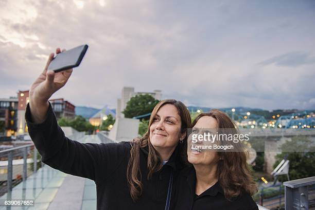 Senior Hispanic Mother and Mature Daughter Taking Selife Chattanooga Tennessee